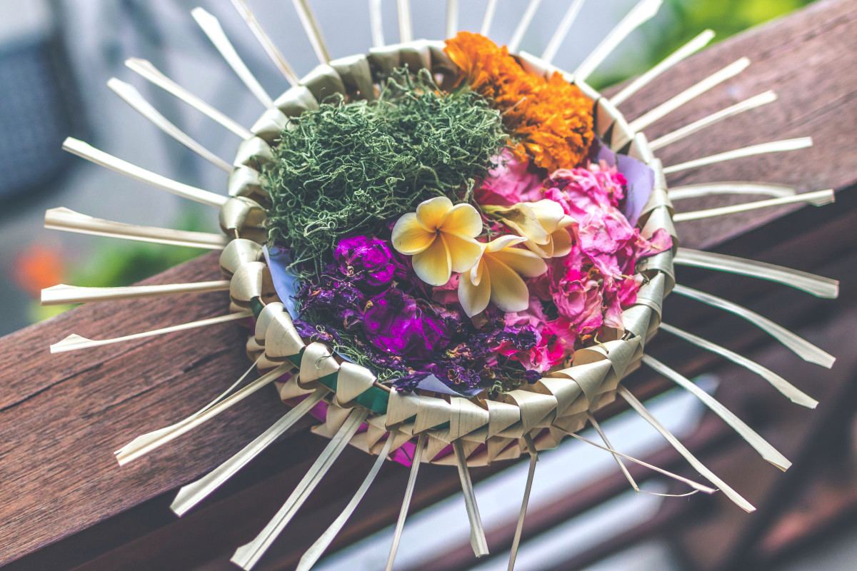 Simply Divine Ceremonies flowers in a weaved basket